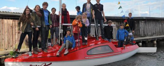 Jugendgruppe tauft eigenen Jollenkreuzer